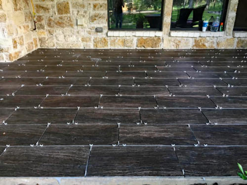 black tile flooring on outdoor patio